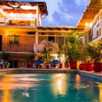 swimming-pool-night-hotel-posada-de-roger-puerto-vallarta